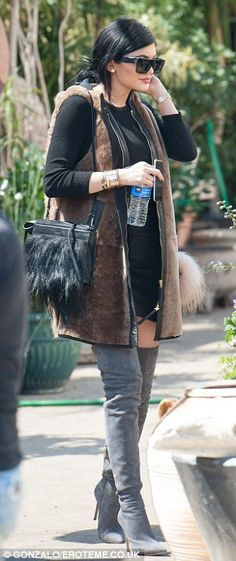 Kylie Jenner steps out in thigh-high boots and a mini-dress in LA #dailymail
