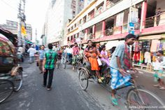 Dhaka cycle-rickshaw driver making his way through the traffic, Dhaka Street Photography, Dhaka, Bangladesh, Indian Sub-Continent, Asia.