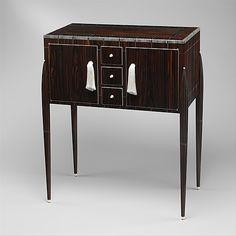 """Fuseaux"" Cabinet  Émile-Jacques Ruhlmann  (French, Paris 1879–1933 Paris)  Date: ca. 1925  Medium: Macassar ebony, ivory, silk, silvered bronze"