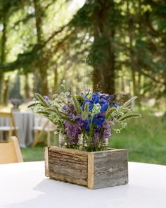 Wildflowers set in rustic wood boxes top the cocktail hour tables.