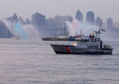 A-U.S. Coast Guard rescue boat from Coast Guard Station Sandy Hook NJ patrols the East River near the Macys fireworks barges.