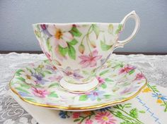 Made in the mid 1930s by Royal Albert in England, this teacup and saucers design is referred to as Summer Glory and features pink white and purple floral all over with green leaves. The set is in awesome vintage condition with no chips, cracks or crazing! It is in the malvern shape. Cup height: 2-3/4 Cup diameter: 3-1/4 Saucer diameter: 5-1/2 Thanks for stopping by! Remember, this is a vintage shop. Almost all of my items are loved vintage/antique items. I will always d...