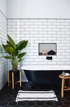 From the black hexagonal tiles on the floor to the white subway tiles on the walls, we love the mix of styles and colours in this bathroom. #whitebathrooms