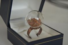 Brass ring with glass bowl and amber