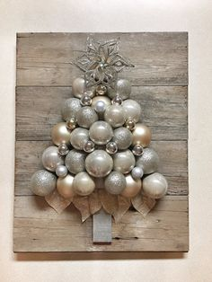 Rustic glam Christmas ornament tree Approximately Shatterproof ornaments mounted on reclaimed weathered shiplap Ornaments are champagne gold and silver Christmas Balls, Christmas Home, Christmas Holidays, Christmas Wreaths, Christmas Ornaments, Christmas Villages, Christmas Christmas, Christmas Projects, Holiday Crafts