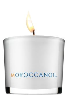"""Free shipping and returns on Moroccanoil® Candle at Nordstrom.com. A delicately fragranced candle releases the MOROCCANOIL® signature scent, which is designed to instantly relax you while filling your space with a warm, soothing ambiance. The candle is made in France from premium European wax and has a natural cotton wick.<br><br>How to use: Dim any overhead lighting to enjoy a warm, candle-lit ambiance that relaxes the senses. Trim the wick regularly to ¼"""" prior to lighting for optimal ..."""