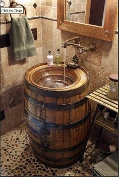 Old barrel = stylish and functional sink! I love the rustic look and earth tones of this room. :) with would be so awesome in the basement bar.