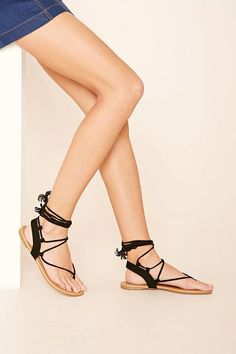 A pair of faux suede sandals featuring a lace-up design and a low heel. #stepitup