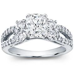 Dream Ring - cushion cut, 3.03 carats, E-color, SI-1 clarity, excellent cut, round and pave setting in 18k white gold from Adiamor