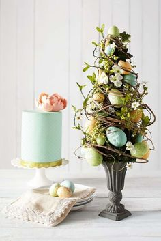 Complement an appetizing Easter buffet table with Pier Blue Speckled Eggs Topiary. Hand-sculpted eggs are woven within a delicate mixture of faux flowers, berries and natural grapevine, all in a classic base. Easter Tree Decorations, Easter Wreaths, Easter Decor, Easter Centerpiece, Spring Decorations, Easter Ideas, Table Decorations, Easter Flower Arrangements, Easter Flowers
