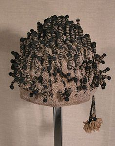 "Crocheted hat, Cameroon. Crocheted cotton with wrapped, protruding ornaments. 6½""x 6."" This hat is more than 60 years old and is in excellent condition. $325"