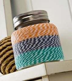 Create a unique votive with your favorite shades of baker's twine and Mod Podge. Baker's twine crafts require no special skills! Crafts With Glass Jars, Mason Jar Crafts, Diy Jars, Twine Crafts, Easy Diy Crafts, Decoupage Jars, Local Craft Fairs, Diy Bottle, Bakers Twine