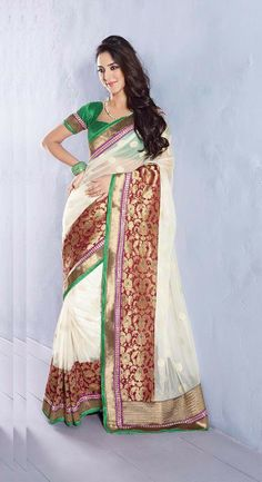 Cream Color Designer Saree.We Create Best Shades To Enhance Your Beauty And Personality. Look Sensationally Awesome In This Saree