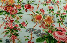 Bastide Fabric in Blue Floral is a colorful, patterned cotton/linen blend upholstery fabric, drapery, or bedding and pillow fabric. Bright and almost tropical, this classic floral print has bursts of roses, blue bells, and hibiscus flowers in shades of pink, green, blue, and yellow, all on a light blue, robin's egg background. Only $20/yard!