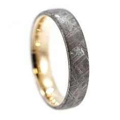 This elegant meteorite ring is perfect as a nontraditional, modern wedding band. The inner sleeve can also be made with rose gold or white gold.