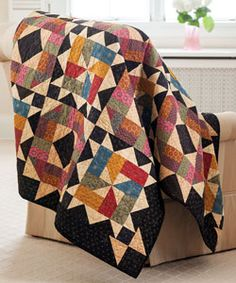 Skillfully orchestrated color combinations create a secondary pattern punctuated by stars in each cross section. This quilt, Starlit Path by Deanne Eisenman, is fat-quarter friendly.