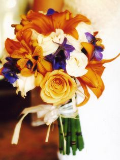 orange wedding flowers with blue accents.  www.florunique.com