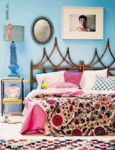 unique boho bedroom with gorgeous embroidered bedspread, floral quilt, blue walls - French 75 Salvage Gypset Bedroom