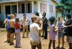 September 1974: Rev. Jim Jones with early settlers of The Peoples Temple Agricultural Project in Jonestown, Guyana. Photo:California Historical Society