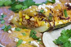 Southwestern Pulled Pork Stuffed Zucchini Boats || This recipe from Chef Gary House of @cookingoutdoors is a great one for using that fresh #summer produce.