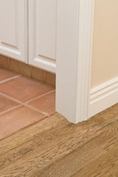 Hollow interior doors consist of a solid wooden frame covered with a wood or composite veneer. The doors are often used for closets, bathroom and bedroom door openings in residential construction. click now for more. Tile Baseboard, Baseboards, Wood Tile Floors, Laminate Flooring, Hardwood Floor, Composite Veneers, Stained Trim, Glossy Paint, Types Of Flooring