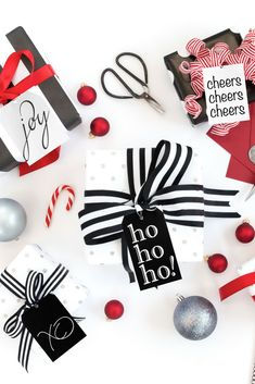 Black and white foil are on these stylish holiday gift tags from WowWordz. Joy, Ho Ho Ho, Cheers and XO tags! Take your pick. @wowwordz #gifttags #christmasgifttags #holidaytags #christmaswrapping #holidaywrapping