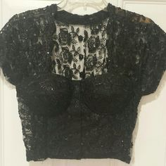 Bustier Beautiful black sequined bustier. Heavy sequins but comfortable.  Eye and hook closure in th front. Tops Camisoles