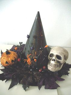 Halloween Witch's Hat Skull Centerpiece @Kelly Krebill this is nice! A varation could deck your table for Halloween.