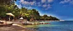 Beach Lone, Rovinj: The whole Lone Bay is an area that belongs to the protected Zlatni Rt (Golden Cape) park forest . The pebbly beach is located near other smaller rocky beaches.