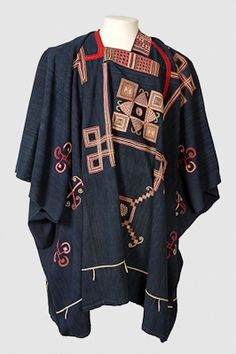 Large dark blue robe with coloured embroidery Cultural Group: Mandinka  Materials: Cotton Textile Plant / Cotton Yarn Plant / Wool Textile Animal / Pigment / ?.  Processes: Embroidered / Woven / Stitched / Dyed / ?. Colour: Dark indigo blue and polychrome  Dimensions: L = 1050 mm W = 1480 mm Maker: Unknown Field  Collected: 1846
