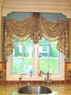 Instead of just a valance or curtains, why not hang a swag from a center medalli. Instead of just a valance or curtains, why not hang a swag from a center medallion over your kitchen window? Unique Window Treatments, Kitchen Window Treatments, Rideaux Design, Beautiful Curtains, Curtain Designs, Curtain Ideas, Custom Windows, Window Styles, Window Design