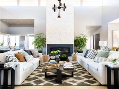 The spacious great room with two inviting sofas, custom designed fireplace and soft, neutral-based textiles offers a comfortable and stylish space for lounging and entertaining. >> http://www.hgtv.com/design/hgtv-smart-home/2017/great-room-pictures-from-hgtv-smart-home-2017-pictures?soc=pinterest
