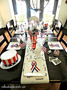 Memorial Day Tribute Table- write the names of men and women down on the paper table runner who lost their lives fighting for our freedom.