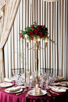 Reception Dinner Decor Details Tall Candlestick Centerpieces | kohl-mansion-san-francisco-wedding-photography-aaronjaclyn
