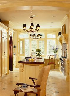 I like the yellow/dark brown contrast and the clean look, but it's a little too fancy for a practical kitchen.... I don't want people to be afraid of breaking something, I'd rather them feel totally comfortable.