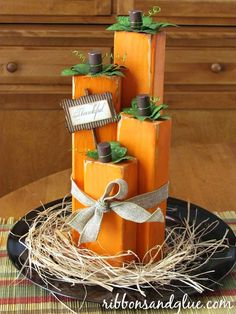 DIY wood block pumpkins made from painted wood blocks cut in different lengths glue together to make a simple Fall pumpkin centerpiece.