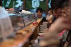 @Sushi Dai (Tsukiji Fish Market, Tokyo) - be prepared to wait for 3 hours in the rain before entering this tiny sushi place right next to the biggest fish market in the world for your sushi breakfast - worth it. :) Counter by Florian Holub on 500px