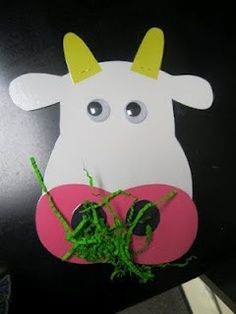 Cow face with grass