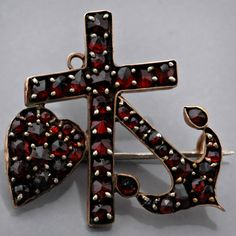 Celebrate Garnet month with us this January; admire the beauty of this Faith, Hope Love Pin, made of antique Victorian Czechoslovakian Bohemian garnets.   Goldsmiths' workshops in Czechoslovakia began using Bohemian garnets during the 13th or 14th century and the specimens of their work can only be found in the National Museum of Prague.  See all the spectacular custom Garnet jewelry at John Wallick Jewelers in Sun City AZ near Phoenix. #johnwallickjewelers #garnet #garnets #famousgarnets