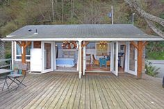 camano-island-beach-cottage--like the way this opens up to the outdoor living room.