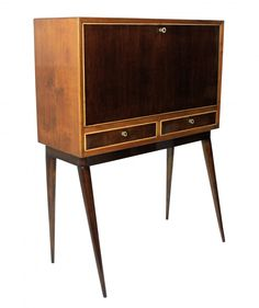 $5,099. This midcentury cabinet was made in Italy in the 1950s. It is made from wood and features a foldout front with drawers on the inside and two additional drawers underneath. Each drawer comes with their own key.