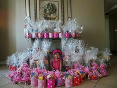 Minnie mouse birthday party - Diy candy cans . Instead of candy bags re-used formula cans