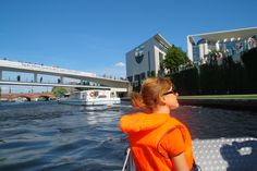 """On a boat trip through the German governmental quarter, offered by the Federal Ministry of the Interior to all staff members helping at the """"Open doors"""""""