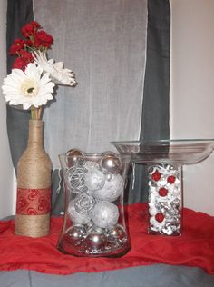 Twine wrapped bottle, silver centerpiece, and candy dish for Valentine wedding.
