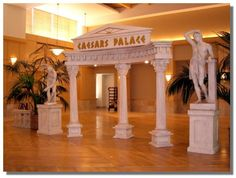 Can not use name but we could change it up. Party decorations in a roman style including collumns and statues Dance Themes, Prom Themes, Greek Party Decorations, Greece Party, Greek Toga, Statues, Toga Party, Prom Decor, Ancient Greece