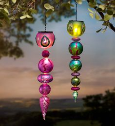 An enchanting garden idea for your backyard: Hanging Solar Glitter Finial Ornament features elegant peacock feather design.