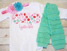 I am in love with this fabric, and you will be too! Each letter of the ONE, is hand cut with a high quality cotton fabric that has red, hot pink, light pink and aqua polka dots. Stunning fabric!  And as added accessories, you will get a pair of aqua ruffle leg warmers and a matching headband. (hot pink ruffle leg warmers are available upon request!)  Cake smash sessions are stunning with this set!! All of my templates are designed by me, hand cut (no cutting machines here!) and then fused…