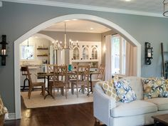 The transformation of the dining room is considerable –with dramatic improvements to the built-in cabinets, new window treatments and an impressive chandelier. Decorative iron sconces with pillar candles accentuate the newly enlarged archway.