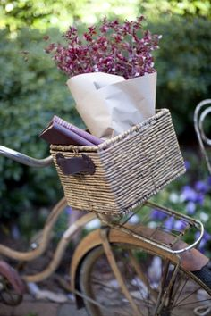 .like that wicker basket on the bike.....flowers and a baguette?