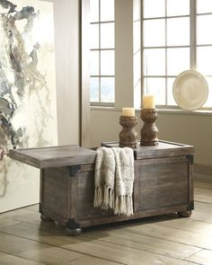 Nice storage for extra cozy blankets and pillows. Rustic and functional.